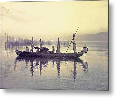 Men In A Canoe In The Bay Of Ambon, Indonesia Metal Print