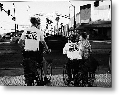 metro police bicycle cops help a tourist with directions in downtown Las Vegas Nevada USA Metal Print by Joe Fox