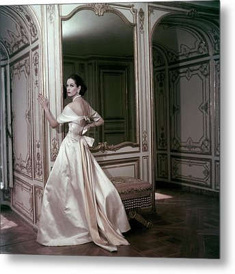 Model Wearing A Satin Evening Dress By Griffe Metal Print