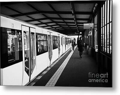 modern yellow u-bahn train sitting at station platform Berlin Germany Metal Print