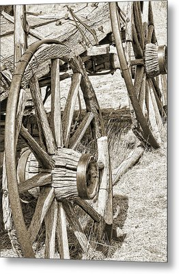 Montana Old Wagon Wheels In Sepia Metal Print by Jennie Marie Schell