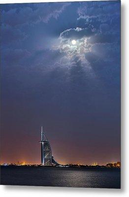 Moon Over Burj Al Arab Hotel Metal Print by Babak Tafreshi