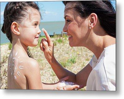 Mother Applying Suncream To Daughter Metal Print