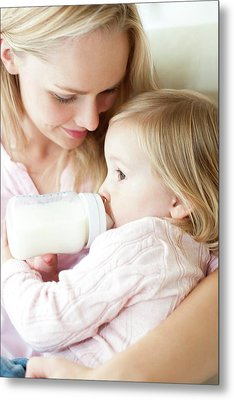 Mother Feeding Daughter With Bottle Metal Print by Ian Hooton