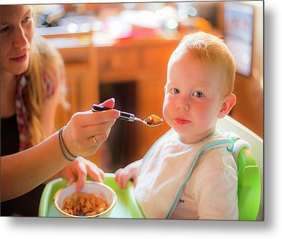 Mother Feeding Her Toddler In A High Chai Metal Print