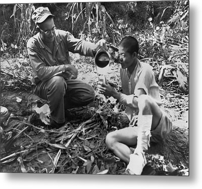 Navy Medic Assists Pow Metal Print by Underwood Archives