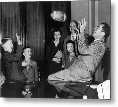 Nixon Catching Football Metal Print by Underwood Archives
