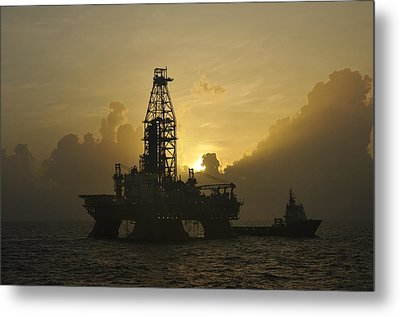 Metal Print featuring the photograph Offshore Oil Rig With Sun And Clouds by Bradford Martin