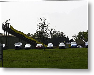 Oil Painting - Parked Vehicles And A Slide For Kids Inside The Blair Drummond Safari Park Metal Print
