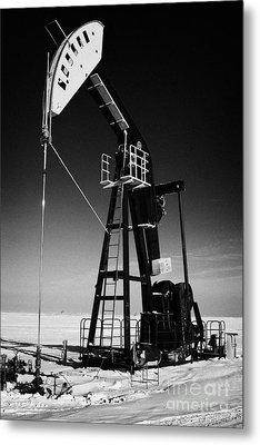 oil pumpjack in winter snow Forget Saskatchewan Canada Metal Print by Joe Fox
