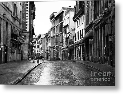 Old Montreal Streets Metal Print by John Rizzuto