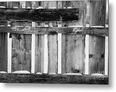 old patched up wooden fence using old bits of wood in snow Forget Metal Print by Joe Fox