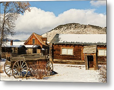 Old Wagon And Ghost Town Buildings Metal Print by Sue Smith