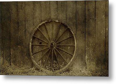 Old Wagon Wheel On Barn Wall Metal Print