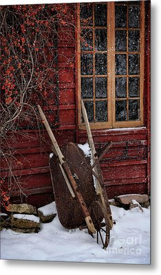 Old Wheelbarrow Leaning Against Barn In Winter Metal Print