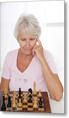 Older Lady Playing Chess Metal Print