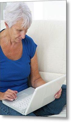 Older Lady Using Laptop Metal Print