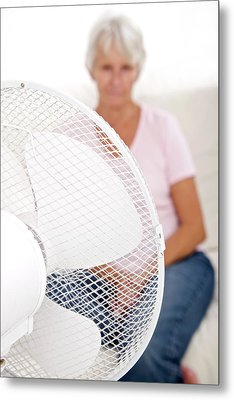 Older Lady With An Electric Fan Metal Print