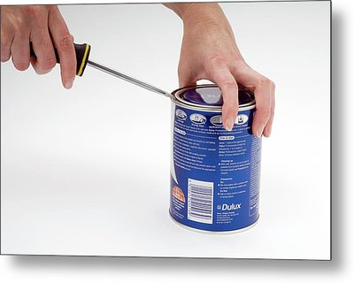 Opening A Can With A Lever Metal Print