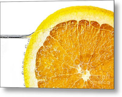 Orange Slice In Water Metal Print by Elena Elisseeva