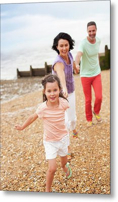 Parents Running On Beach With Daughter Metal Print by Ian Hooton
