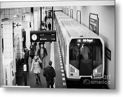 passengers on ubahn train platform as train leaves Friedrichstrasse u-bahn station Berlin Germany Metal Print