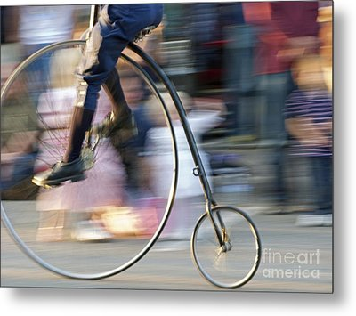 Pedaling Past Metal Print by Ann Horn