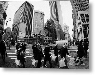 Pedestrians Crossing Crosswalk On 7th Ave And 34th Street Outside Macys New York City Usa Metal Print by Joe Fox