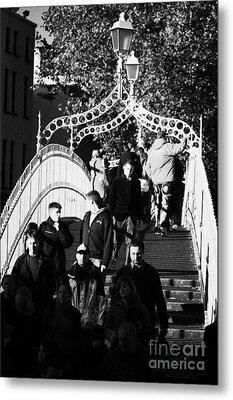 People Crossing The Hapenny Ha Penny Bridge Over The River Liffey In Dublin At A Busy Time Vertical Metal Print by Joe Fox