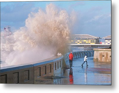 People Dodging Storm Waves Metal Print by Ashley Cooper