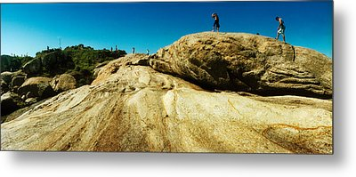 People Hiking Along The Boulders That Metal Print by Panoramic Images