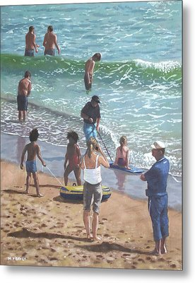 people on Bournemouth beach pulling dingys Metal Print by Martin Davey