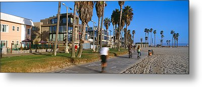 People Riding Bicycles Near A Beach Metal Print by Panoramic Images