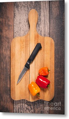 Peppers And Knife On Cutting Board Metal Print by Sharon Dominick