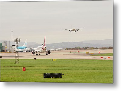 Plane Coming In To Manchester Airport Metal Print by Ashley Cooper