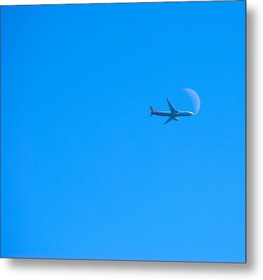 Plane Crossing The Moon Metal Print