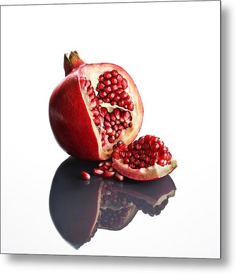Pomegranate Opened Up On Reflective Surface Metal Print