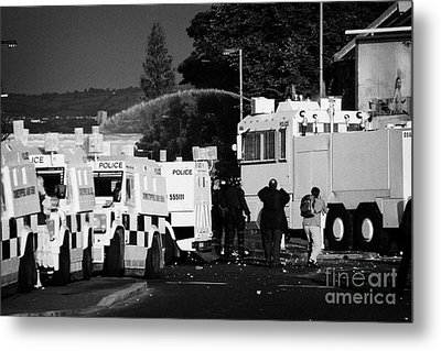Psni Armoured Land Rovers And Water Canon On Crumlin Road At Ardoyne Shops Belfast 12th July Metal Print