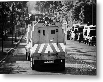 Psni Land Rovers Head Up The Crumlin Road Towards Loyalists At Ardoyne Shops Belfast 12th July Metal Print by Joe Fox
