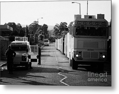 Psni Landrover And Watercannon In Wait In Preparation On Crumlin Road At Ardoyne Shops Belfast 12th  Metal Print