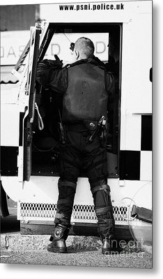 Psni Officer Puts On Protective Ruiot Gear On Crumlin Road At Ardoyne Shops Belfast 12th July Metal Print by Joe Fox