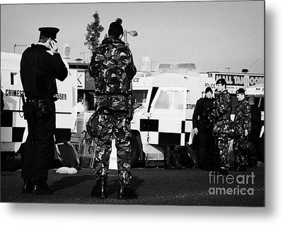 Psni Officers And British Army Soldiers At Psni Landrovers On Crumlin Road At Ardoyne Shops Belfast  Metal Print by Joe Fox