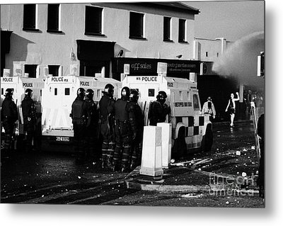 Psni Officers Watch Rioters Being Hit By Water Canon On Crumlin Road At Ardoyne Shops Belfast 12th J Metal Print