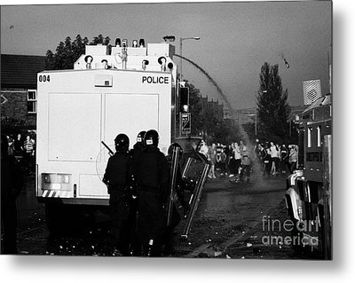 Psni Riot Officers Behind Water Canon During Rioting On Crumlin Road At Ardoyne Metal Print
