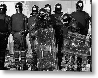 Psni Riot Officers Tend To Injured Colleague During Riot On Crumlin Road At Ardoyne Shops Belfast 12 Metal Print by Joe Fox