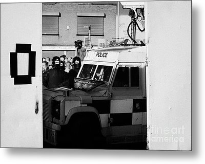 Psni Surveillance Land Rover Watches Crowd On Crumlin Road At Ardoyne Shops Belfast 12th July Metal Print by Joe Fox