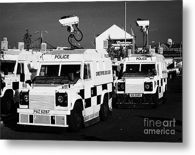 Psni Surveillance Landrovers With Cameras On Crumlin Road At Ardoyne Shops Belfast 12th July Metal Print by Joe Fox