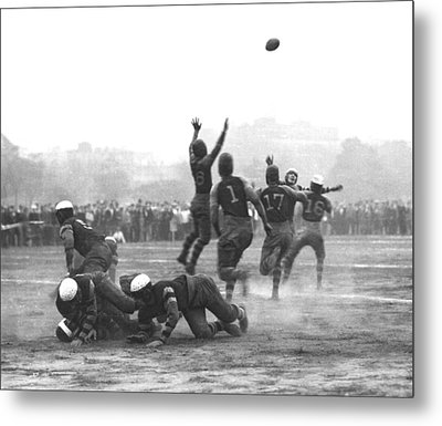 Quarterback Throwing Football Metal Print by Underwood Archives