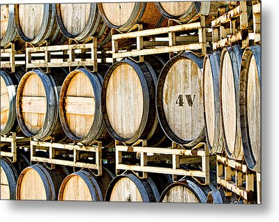 Rack Of Old Oak Wine Barrels Metal Print by Susan Schmitz