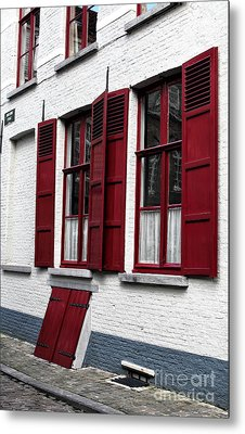 Red And White In Bruges Metal Print by John Rizzuto